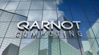 Editorial, Qarnot computing logo on glass building.