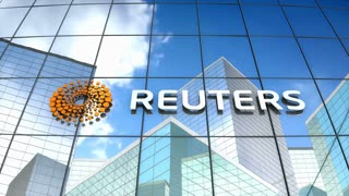 Editorial, Reuters logo on glass building.