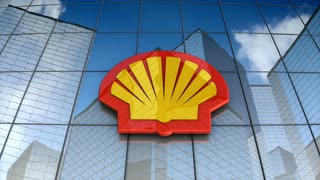 Editorial, Royal Ducth Shell plc logo on glass building.