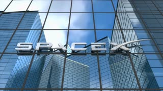 Editorial, SpaceX logo on glass building.