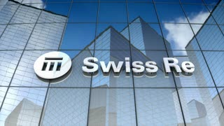 Editorial, Swiss Reinsurance Company Ltd logo on glass building.