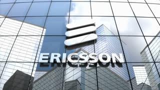 Editorial, Telefonaktiebolaget L. M. Ericsson logo on glass building.