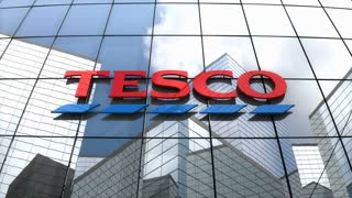 Editorial, Tesco plc logo on glass building.