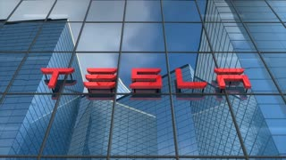Editorial, Tesla logo on glass building.