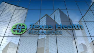 Editorial, Texas Health Resources logo on glass building.