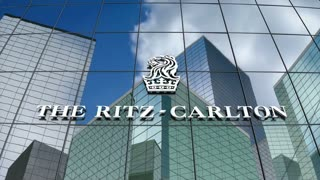 Editorial, The Ritz-Carlton Hotel Company LLC logo on glass building.