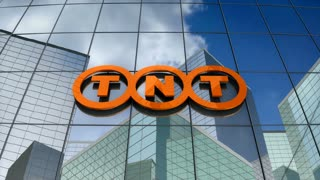 Editorial, TNT Express logo on glass building.