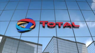 Editorial Total logo on glass building.