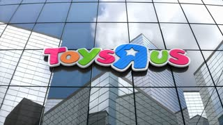 "Editorial, Toys ""R"" Us logo on glass building."