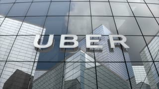 Editorial, Uber logo on glass building.