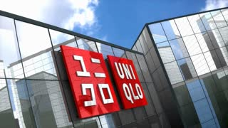 Editorial, Uniqlo Co., Ltd. logo on glass building.
