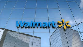 Editorial Walmart logo on glass building.
