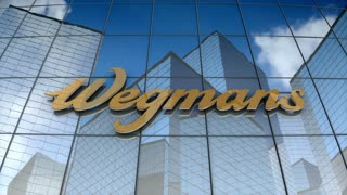 Editorial, Wegmans Food Market, Inc. logo on glass building.