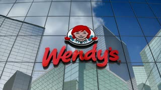 Editorial, Wendy's logo on glass building.