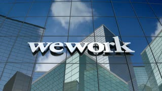 Editorial, WeWork logo on glass building.