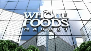 Editorial, Whole Foods Market Inc. logo on glass building.
