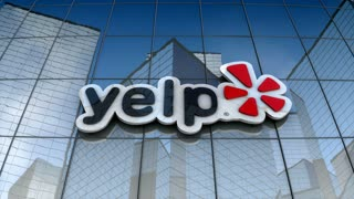 Editorial, Yelp logo on glass building.