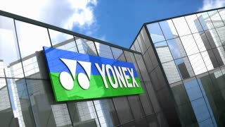 Editorial, Yonex Co., Ltd. logo on glass building.
