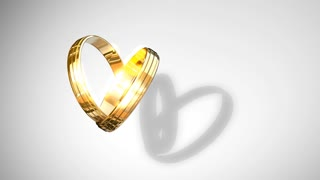 Wedding rings animtion forming heart shaped shades.