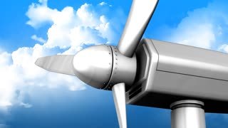 Windturbine fan close up with blue sky as background.