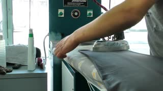 Ironing In Dry Cleaning Shop 4