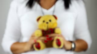 Showing Bear Toy on Hand