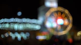 Amusement park at night, the bright lights are lit Ferris wheel. 4k video background