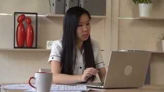 Asian young professional woman working in casual office