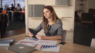 Busy woman try to save time hold the meeting via internet. She discuss with partner plans and profit