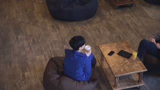 Coffee break man with a woman resting and talking