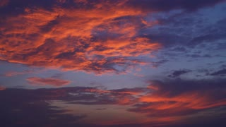 evening sky with thunderclouds. Natural view with blue and red, magenta colors clouds