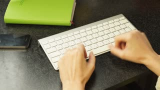 Female hands fast typing on the keyboard