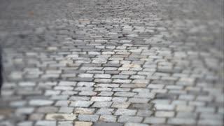 Man goes forward on a stone slab. UHD video
