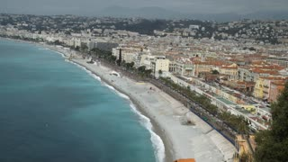 Mediterranean country with amazing sea and promenade with walking people. On the beach working men and vehicles