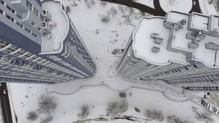 Panorama home downward movement of the air. It is snow on the roof. Taking the building from the air overhead view. 4k video