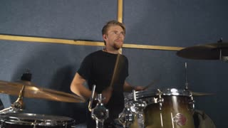 Portrait caucasian man playing on drum kit. Handsome musician enjoy performance singing on the concert or try-out. Drummer guy plays on the drums set on his young face we can see different emotions