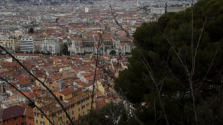 Sity view Nice France Cote d'Azur. Top view on the urban old european town with beautiful architecture and sea with the promenade and the beach. Seashore with walks tourists and road with cars and