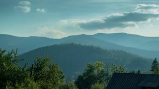 The movement of clouds over the summer forest. The foothills of the Carpathians covered with forest. 4K. Time-lapse
