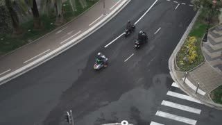 Upper view on the road with mowing cars at summer day in Nice France. Top view on the bicycle path with sign for cyclists