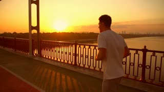 active guy doing a morning jog. male runner doing cardio.