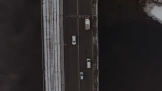 aerial view on the driving cars on bridge. Vehicles moving on the street