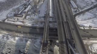 aerial view on the road and railways. Urban landscape in winter season. Train and cars are going by the town