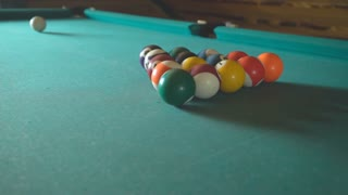 Aiming the man beats cue on the ball and breaks the pyramid in American billiards HD video