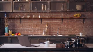 busy business woman hurries to office. Businesswoman drinking coffee in kitchen in modern apartment