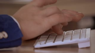 close up details man hands typing on white keyboard. unrecognizable person working on computer