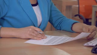 close up details unrecognizable businesswoman holding contract and sign a signature