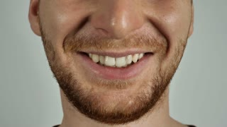 close up face unrecognizable man without eyes smiling. caucasian male with beard laughing