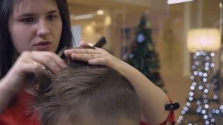 Closeup haircutter cut blond hair. Details in barbershop