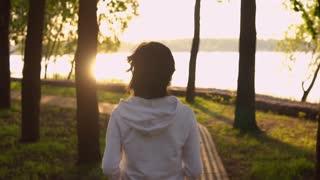fitness sport model run at sunrise slow motion. unrecognizable runner jogging sunlight. active lifestyle