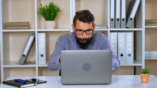funny business man using laptop showing different emotions success, failure and tired after hard project. handsome employee with beard and mustache looks like crazy man